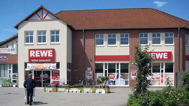 Office, residential and commercial building with a REWE shop in Gifhorn marketed